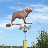 copper bulldog weathervane right side view on blue sky background