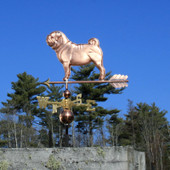 Pug Weathervane left side view on blue sky background