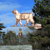 large walking bobtail cat weathervane left angle view on blue cloudy background