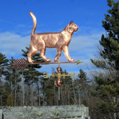 large walking cat weathervane right side view on blue sky background