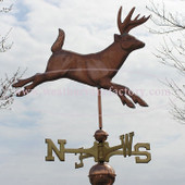 deer weathervane right side view on stormy background image