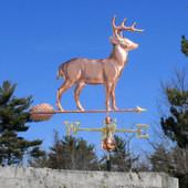 large standing deer weathervane side image on blue sky background