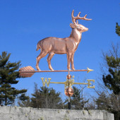 large copper standing deer weathervane right side view on blue sky background