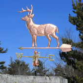 large copper standing deer weathervane left side view on blue sky background