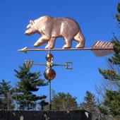 large bear weathervane side view on blue sky background photo