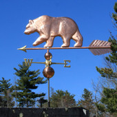 large bear weathervane left side view on blue sky background