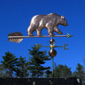 large bear weathervane right side view on blue sky background
