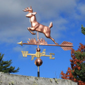 leaping deer weathervane left angle view on cloudy sky background