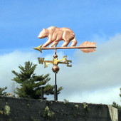 Bear Weathervane right side view on blue and cloudy sky