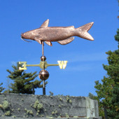 catfish weathervane left side view on blue sky background