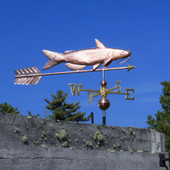 large catfish weathervane with arrow on right side view with blue sky background