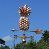 Pineapple weathervane left side view on blue sky background