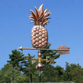 Pineapple weathervane left angle/ side view on blue sky background
