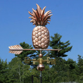 Pineapple weathervane right side view on blue sky background