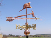 fire hat and ax weathervane right side view on blue sky background