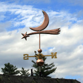 shooting star and moon weathervane left view angle on blue sky and cloudy background