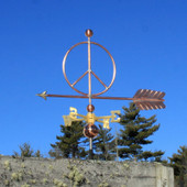 peace sign weathervane left front view on blue sky