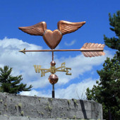 Heart with Wings Weathervane  left angle view on blue sky cloudy background