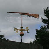 Gun Weathervane left side view on stormy background