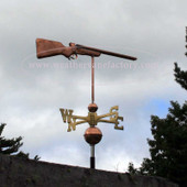 Gun Weathervane right side view on stormy background