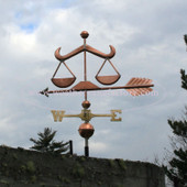 Scales of Justice Weathervane left side view with cloudy sky background