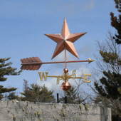 Star weathervane right side view on blue sky background