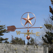 Large Star in a Circle Weathervane blue sky background, right side view