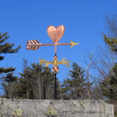 Small Copper Heart Weathervane on a blue sky background right side view