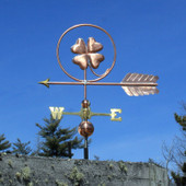 Four leaf clover Weathervane right left side view on blue sky background.
