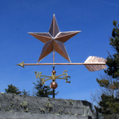 Large Copper Star Weatherane left side view on blue sky background
