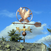 Oak Leaves and Acorn Weathervane left side vie on cloudy sky background