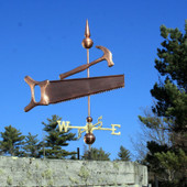 Large Saw and Hammer Weathervane right side view on blue sky background