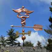 caduceus / medical weathervane left side view on cloudy sky background