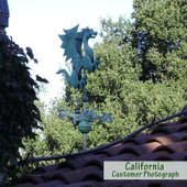 One of my favorite customer photo of our dragon in patina out in California in the Napa Valley. This dragon is mounted on one of our eave mounts and is shown with the patina scrolled directionals.