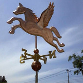 Large Pegasus Weathervane angle left side view on cloudy sky background