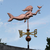 mermaid weathervane with martini glass right side view on blue sky background