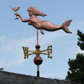 Mermaid Weathervane left side view on blue sky background