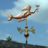 mermaid with martini glass and bottle weathervane right side view on cloudy sky background