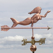 swimming mermaid weathervane right side view on gray sky background