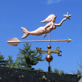 mermaid weathervane holding a star right side view on blue sky background