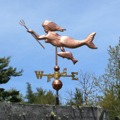 mermaid with spear and fish weathervane left side view on blue sky background
