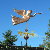 Angel Weathervane right rear view on blue sky background