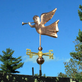 Angel Weathervane left rear view on blue sky background