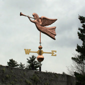angel weathervane blowing trumpet left front view on gray sky background