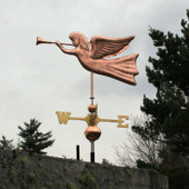 angel weathervane blowing trumpet side view on gray sky background