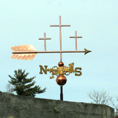 three crosses weathervane right side view on blue sky background