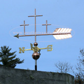 three crosses weathervane left side view on blue sky background