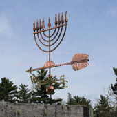 Large Menorah Weathervane rear view on blue sky background
