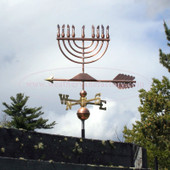 Menorah Weathervane left side view on cloudy sky background