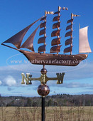 tall ship weathervane left side view on blue sky background